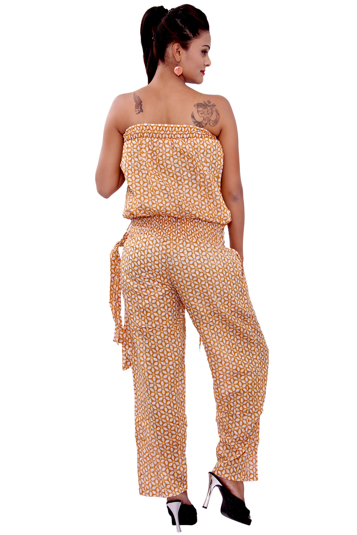 The '!7 Again Jumpsuit' is a simple and classic piece that will make the cut for any occasion. featuring a thin adjustable strap with V neckline, shirred waistline and flare leg with side split detail.